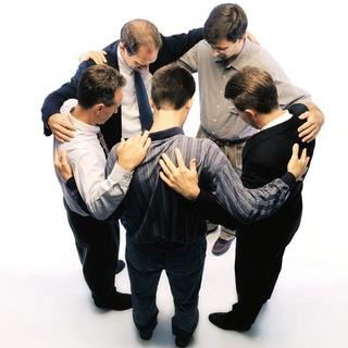 Group of business people praying together